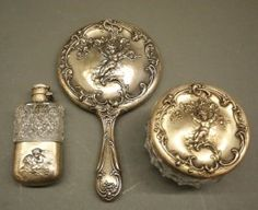 Auctioneer: Schmidt's Antiques Inc. Since New Year's Day Gallery Auction, Date: January 2017 GMT, Location: Ypsilanti, MI, United States Vanity Set, Schmidt, Cupid, Auction, Sterling Silver, American, Antiques, Gallery, Tableware