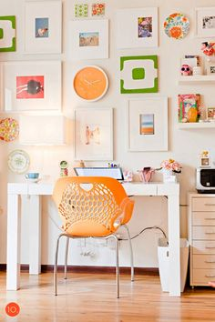 Bright and cheery office gallery wall. I like the way it revolves around the clock – and that the clock picks up the color from the chair. It's a subtle touch, but I think that would please me every time I sat down to work. The sunny orange appears in several art prints for an organic - but very on purpose - kind of harmony.