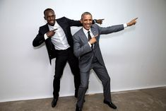 """President Obama poses with Usain Bolt backstage following a """"Young Leaders of the Americas Initiative"""" town hall at the University of the West Indies in Kingston, Jamaica"""