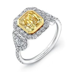 Natureal Collection Platinum and 18K Yellow Gold Radiant-Cut Fancy Yellow Diamond Engagement Ring LVS590 - This ring features a gorgeous platinum and 18K yellow gold single shank with perfect radiant-cut fancy yellow diamond with a total weight of 1.67 carats.  The ring is complimented with 2 shield white diamond sidestones with a total weight of .31 ct. and 55 round white diamonds with a total weight of .70 ct.