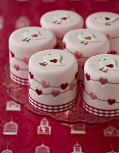 Precious little red bird and heart garland mini cakes with gingham trim.