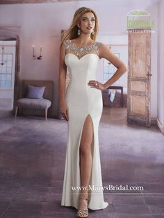 Stretch jersey sheath bridal gown with detailed bead work on bateau neckline. Style 2628 by Mary's.