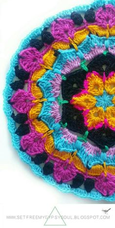 African Flower Mandala Blue Hawaii Free Crochet Pattern - Love the African Flower Granny Square? Try this African Flower Blue Hawaii crochet Mandala and add tropical boho-vibes to your home using a combo of treble crochet, double crochet, and loops. Mandala Motif, Crochet Mandala Pattern, Crochet Motifs, Granny Square Crochet Pattern, Crochet Flower Patterns, Crochet Squares, Crochet Granny, Double Crochet, Knitting Patterns