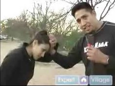 Learn how to defend against a hair grab in this free women's self defense video.