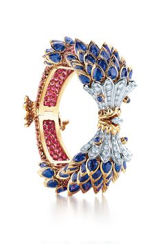 Tiffany & Co. Schlumberger® Fish bracelet in 18k gold and platinum with sapphires, red spinels and diamonds. #Tiffany