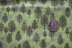 Ingrid Slyder, Winter Wonderland,  Pine Trees on Green Fabric - By the Yard. $7,50, via Etsy.