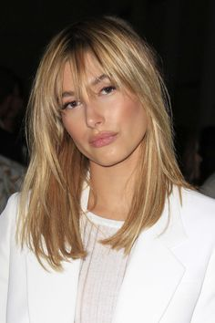 "We can't get enough of Hailey's look here. She was FROW at Fashion Week with a gorgeous layered hairstyle and accompanying long choppy  [link url=""http://www.glamourmagazine.co.uk/beauty/celebrity/hair/2009/08/12/celebrity-fringes""]bangs[/link] ."