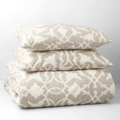 A modern take on an elegant floral scroll pattern, the comforter and shams in this set features the bold print on the front and reverse. | Cotton; polyester | Machine wash | Imported | Set includes: c