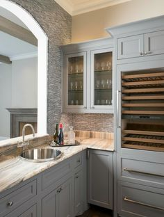 Butler pantry with painted gray cabinets, wine refrigerator, and granite counters. #kitchen #design #ideas