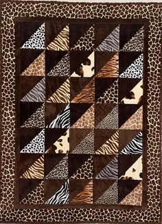 On a Safari Cuddle Quilt Kit. Designed by Christine Stainbrook of Project House 360 http://projecthouse360.com/. Instructions by Keepsake Quilting. Features Cuddle Cakes precuts Hot Chocolate http://www.shannonfabrics.com/cuddle-cakes-hot-chocolate-p-6745.html and Adorable Animals http://www.shannonfabrics.com/cuddle-cakes-adorable-animals-p-6582.html Appeared in Quilting Quickly - May-June 2015 #OnASafari #CuddlePrecuts #ProjectHouse360