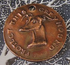 PROTECT THIS GREYHOUND collar tag by Dianne Kresevich. Guardian angel on reverse. $19.00, via Etsy.