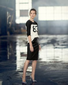 A Varsity T-Shirt and Leather Skirt from J.Crew's September Style Guide: (http://racked.com/archives/2014/08/18/jcrew-september-style-guide.php)