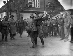 Soviet and American soldiers share a dance upon their meet-up at the River Elbe near Torgau. April 26th 1945. [2805 x 2174]