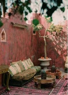 Such a delightful courtyard - great colors and style! #design #bohemian