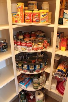 Lazy Susan Pantry for-the-home.  Great way to maximize corner spaces