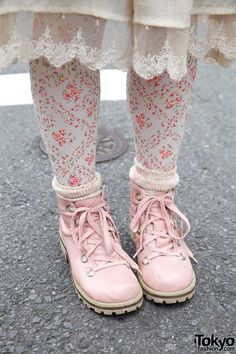 Lacy hem on skirt followed by pink/white leggings and pink hiking boots.