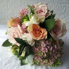 Summer wedding bouquet roses freesia lisianthus hydrangea