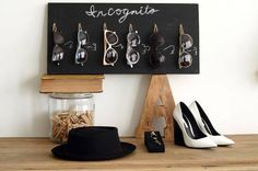 Here's a unique way to organize your sunglasses!   http://www.huffingtonpost.com/mr-kate/diy-chalkboard-sunglasses_b_6583124.html