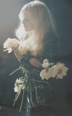 I've been picking these beautiful daisies, they are daisies aren't they? For DM who became a mother again at The Yellow House on the Corner. Oh, I need to put my hair up, it's so humid today............... By Tim Walker