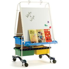 An economical teaching easel with storage! The Regal Reading/Writing Center features a magnetic dry-erase surface on front that supports wide chart pa National School Furniture Apps For Teaching, Teaching Tools, Teaching Ideas, Teaching Supplies, Classroom Furniture, School Furniture, Furniture Ideas, Free Lesson Plans, Lesson Plan Templates
