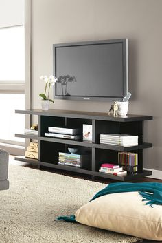 Handcrafted by skilled Wisconsin woodworkers, Graham is a modern, functional media console with storage shelves built into its distinctive profile.
