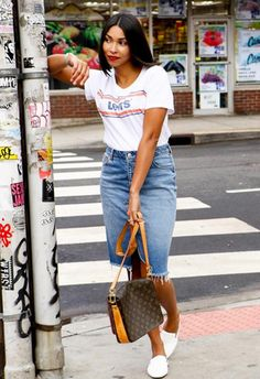 Your faithful white tee has had the 70s varsity treatment (let your inspo be Matthew McConaughey circa Dazed & Confused) and your summer wardrobe has never looked better. Keep the look fresh by adding forever staples, such as a midi frayed jean skirt and white loafers. Then, clash up your eras to make your outfit pop and enlist the help of a 90s vintage crossbody