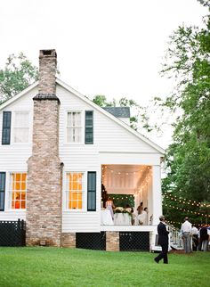 that white farmhouse with the black shutters and a wrap around porch...
