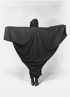 Stunning black and white picture of a cape by Issey Miyake in architectural style. via google.com