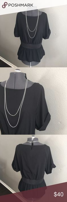 Banana republic black blouse size large Banana republic black blouse size large. In excellent condition. Elastic on waist to flatter your figure. This shirt is perfect for your night out for a day at the office. Pit to pit measurement proximately 18 inches length from shoulder approximately 22 inches waist approximately 15 1/2 inches Banana Republic Tops Blouses