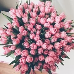 A baby pink bouquet with green leaves.