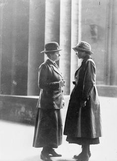 Female police patrol advising a female traveller at Euston station, 1918