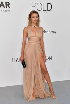 Natasha Poly in Dsquared2 attends the AmfAR Gala during the 70th Annual Cannes Film Festival