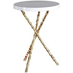 A textured, spindle iron frame lends rustic appeal to the clean lines of the Diego side table. With a sleek resin top, it makes a beautiful transition piece next to a sofa or arm chair. Shown in antiqued gold and gloss white, this round table is available in your choice of finish for a customized look. #shopcandelabra #tinitables