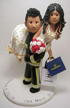 Fireman's lift wedding cake topper