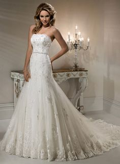 Natasha - by Maggie Sottero....i absolutely want lace in my dress.. i think all of her dresses are amazing
