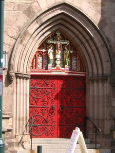 red church doors...sanctuary...blood of Christ