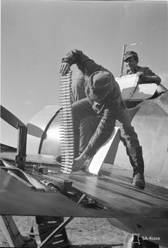 Finnish ground crew load .50 rounds into a Brewster B-239.