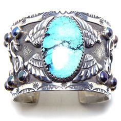 Large sterling silver & turquoise cuff with wings, black pearls and other D icons... by Demian & Alex - D  #southwestern #cowboy boots #lucchese #sterling #silver #cross #turquoise #cowboy #jewelry #crosses #D #Demian & Alex #Vazquez www.dandabrothers.com