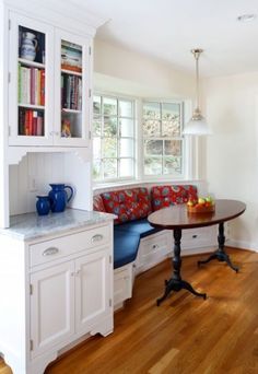 Do you have an empty space in your kitchen that you aren't quite sure what to do with? Put a built-in bench in that space, and pop a little table in front of it for an instant breakfast nook!