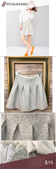 "Gap Preppy Fit And Flare Neoprene Skirt Casual and chic neoprene, scuba knit fit and flare skirt in a heathered gray. This piece looks fresh and forward when paired with a classic button down and loafers. Such a great addition to any wardrobe!! Size: Large Measurements: Waist (15.5"") Hips (25.5"") Length (18"") GAP Skirts Circle & Skater"