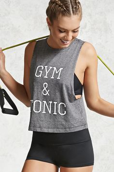 "A marled knit muscle tee featuring a front ""Gym & Tonic"" graphic, round neckline, dropped raw-cut armholes, and a relaxed silhouette. Cute Workout Outfits, Womens Workout Outfits, Sporty Outfits, Workout Wear, Junior Fashion, Sport Fashion, Athletic Wear, Athletic Tank Tops, Zumba"
