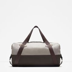 $69.90 Holdall. Green and beige color combination. Zip fastening. With handles and shoulder strap. Inside pocket with zip. Height x Width x Depth: 27 x 45 x 27 cm.