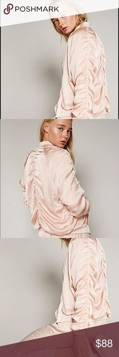 Luxe Satin Bomber 🍃 Perfect for morning runs or lounging around after one, this luxe, retro-inspired silky bomber features allover ruched detailing with contrast ribbed trim. Zip front closure and side sleeve pocket with snap closures. American made.   *By FP Movement *100% Polyester *Lining: 95% Rayon, 5% Spandex *Machine Wash Cold *Made in the USA  Measurements for size: Small *Bust: 40.0 = 101.6 *Length: 24.0 = 61.0 *Sleeve Length: 28.8 = 73.0. Beautiful Blush Color new w tags!! Awesome…