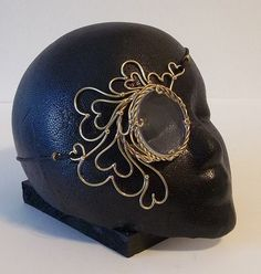 Hey, I found this really awesome Etsy listing at http://www.etsy.com/listing/154038703/bronze-queen-of-hearts-steampunk-monocle