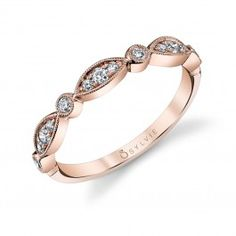 This vintage milgrain edge 14K rose gold band features alternating marquise and round shapes with 0.22 carats of round brilliant diamonds. Pair with our other stackable bands for a unique look.