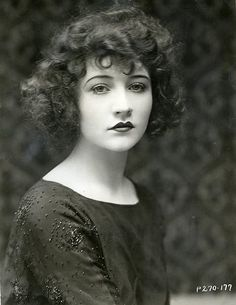vintage photo---Probably 20's going by the hairstyle and makeup choices. Note the Cupid bow lips and thin arched brows.