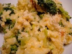 "Cheesy Broccoli with Chicken and Rice Casserole  ""This has got to be one of the BEST casseroles ever!  What I love about it is. . .  it has NO processed 'cream of soup' in it, that makes the dish taste so much better.  This dish makes a lot so I will usually make this dish when taking dinner over to a friends who just had a baby or is sick etc.. . . In that case I will cook it in two pans.   This dish also makes for great leftovers if you have no friends in need of a meal. :-)"""
