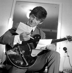 The Beatles: George Harrison reading some fan mail.