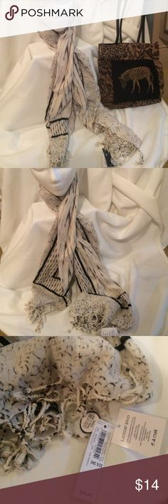 Land's End  Ikat Linen/Cotten Scarf New with tags lands end Ikat fringe scarf  in eggshell and black print (there is also some light brown ) Really nice linen/Cotten scarf Lands' End Accessories Scarves & Wraps