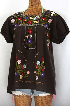 "This summer, cool down with the ""La Belleza"" Mexican Blouse in Chocolate Brown by Siren.  Gathered sleeves and elaborate embroidery detail give the Belleza an authentic, vintage flair.  Perfect for Summer!  Light and airy, perfect for a #SUP #paddleboard around the bay! $48.95"